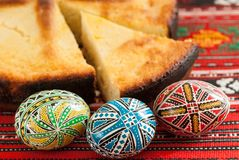 Traditional romanian easter bread pasca with cheese and raisins and nicely decorated easter eggs orthodox tradition. Traditional romanian easter bread pasca with Royalty Free Stock Photos