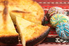 Traditional romanian easter bread pasca with cheese and raisins and nicely decorated easter eggs orthodox tradition. Traditional romanian easter bread pasca with royalty free stock photo