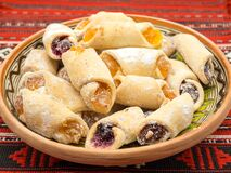 Free Traditional Romanian Festive Dessert Dumplings Filled With Assorted Turkish Delight Served On A Traditional Cloth Royalty Free Stock Photo - 180110175