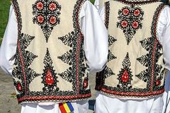 Traditional Romanian folk costume.Detail 34. Two people with old traditional Romanian folk costume. Specific Banat, Romania Royalty Free Stock Images