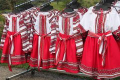 Traditional Romanian folk costumes for girls exposed for sale at one traditional fair stock photo