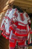 Traditional Romanian folk costumes for little girls. With embroidery, exposed for sale at one traditional fair Royalty Free Stock Photo