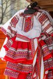 Traditional Romanian folk costumes for little girls. With embroidery, exposed for sale at one traditional fair stock images
