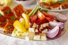 Traditional Romanian Food platter brunch with vegetables fresh o. Nions and cheeses stock photo