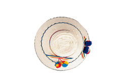 Top of an traditional Romanian hat made of straws, isolated against a white background Royalty Free Stock Photo