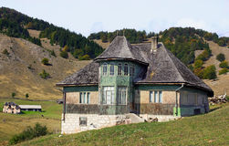 Traditional Romanian house. Old house located on the top of the Carpathian Mountains Royalty Free Stock Image