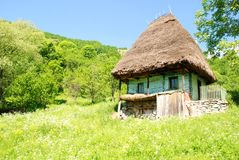 Traditional romanian house with straw roof Royalty Free Stock Photo