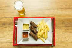 Traditional Romanian Mici And Beer Royalty Free Stock Image