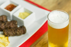 Traditional Romanian Mici And Beer Stock Photos