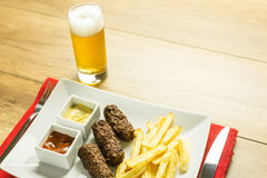 Traditional Romanian Mici And Beer Royalty Free Stock Images