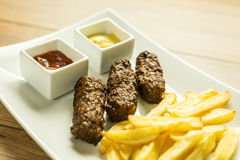 Traditional Romanian Mici Plate Close Up Stock Photography