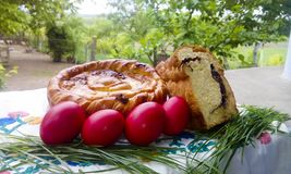 Traditional Romanian pasca, sweet bread and Easter eggs. In a Easter arrangement on countryside Stock Photography