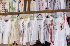 Traditional Romanian peasant blouses. At a fair royalty free stock images