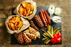 Traditional romanian platter. Potatoes, fried meat, littles and pickles on plate. Traditional romanian food Stock Photo