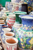 Traditional romanian pottery in market. Traditional pottery with floral ornaments in a handmade market Stock Photos