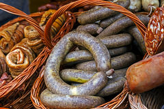 Traditional Romanian sausages specialty in a wicker basket Royalty Free Stock Photography