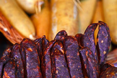 Traditional romanian sausages in a wicker basket  Stock Images