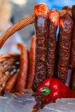Traditional romanian sausages in a wicker basket  Royalty Free Stock Photography