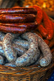 Traditional romanian sausages in a wicker basket  Royalty Free Stock Photo