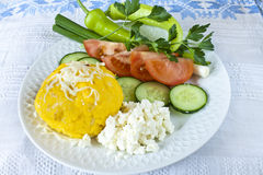 Traditional romanian vegetarian  food. Traditional Romanian food with  polenta, cheese and vegetables Royalty Free Stock Photography