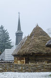 Traditional romanian house. Romanian village with wooden houses and church spire Stock Image