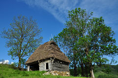 Traditional Romanian wooden barn with thatched roof Stock Photos