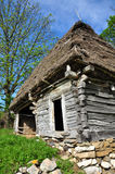Traditional Romanian wooden barn with thatched roof Royalty Free Stock Images