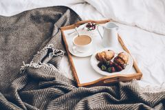 Traditional romantic breakfast in bed in white and beige bedroom Royalty Free Stock Photos
