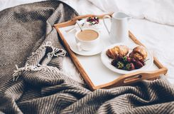 Traditional romantic breakfast in bed in white and beige bedroom Royalty Free Stock Photography