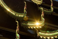 Traditional roof of Buddhism temple with flare light in Chiang M Stock Image