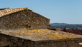 Traditional roof of a building in Catalan. Traditional roof of a building in Spain , city Pals royalty free stock photo