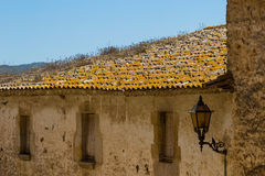 Traditional roof of a building in Catalan. Traditional roof of a building in Spain , city Pals stock image