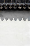 Traditional roof tiles and white wall, Suzhou Stock Images