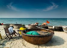 Traditional round craft on the beach, Hoi An - Vietnam. Traditional fishing on a sandy beach royalty free stock photos