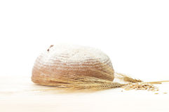 Traditional round rye bread. Traditional round rye bread lyingon the table and isolated on white background Stock Image