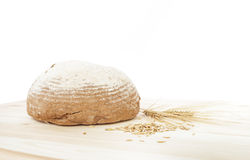 Traditional round rye bread. Traditional round rye bread lyingon the table and isolated on white background Royalty Free Stock Photography