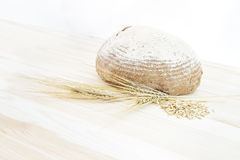 Traditional round rye bread. Traditional round rye bread lyingon the table and isolated on white background Stock Photos