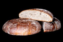 Traditional round sourdough bread. Traditional round sourdough bread isolated on black Royalty Free Stock Images