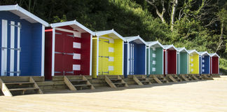 Traditional row of colourful beach huts Royalty Free Stock Images