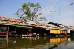 Wooden row house on river side, Thailand. Royalty Free Stock Photos