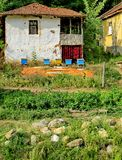 Traditional rural environment: house, drying peppers, hives Royalty Free Stock Photos