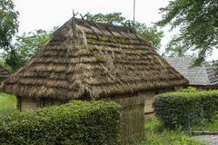 Traditional rural  historical house of the Western Ukraine where the roof is covered with straw. Skansen Uzhohrod. Ukraine.  Stock Images