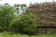 Traditional rural  historical house of the Western Ukraine where the roof is covered with straw. Skansen Uzhohrod. Ukraine.  Stock Photos