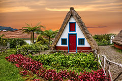 Traditional rural house in Santana Madeira, Portugal. Sunset vie Royalty Free Stock Photo