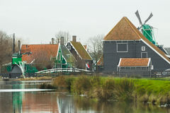 Traditional rural settlement in old Holland with old windmills and river Stock Images
