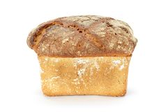 Traditional rural wheat bread on a white background royalty free stock photography