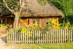Traditional rural wooden cottage house Stock Photos