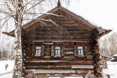 Traditional rural wooden house in winter Stock Photo