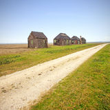 Traditional rural wooden huts in italian countryside. Country road. Stock Photo
