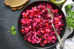Traditional russian beetroot salad vinaigrette on a dark plate . Stock Image
